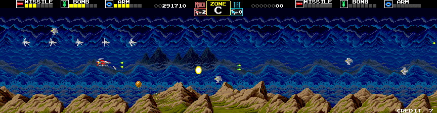Darius Arcade Screenshot: Zone C; collect the gold sphere to destroy all opponents on the screen.