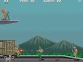 M.I.A.: Missing in Action for Arcade - Using a machine gun to blast enemies...