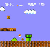 Super Mario Bros. for NES / Famicom - Pick up the mushrooms to increase in size!