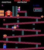 Donkey Kong for Arcade - Jump over barrels to reach the top.