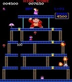 Donkey Kong for Arcade - Avoid those fireballs that chase you!