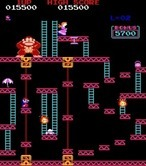 Donkey Kong for Arcade - Jumping on the numerous small platforms to reach the top...